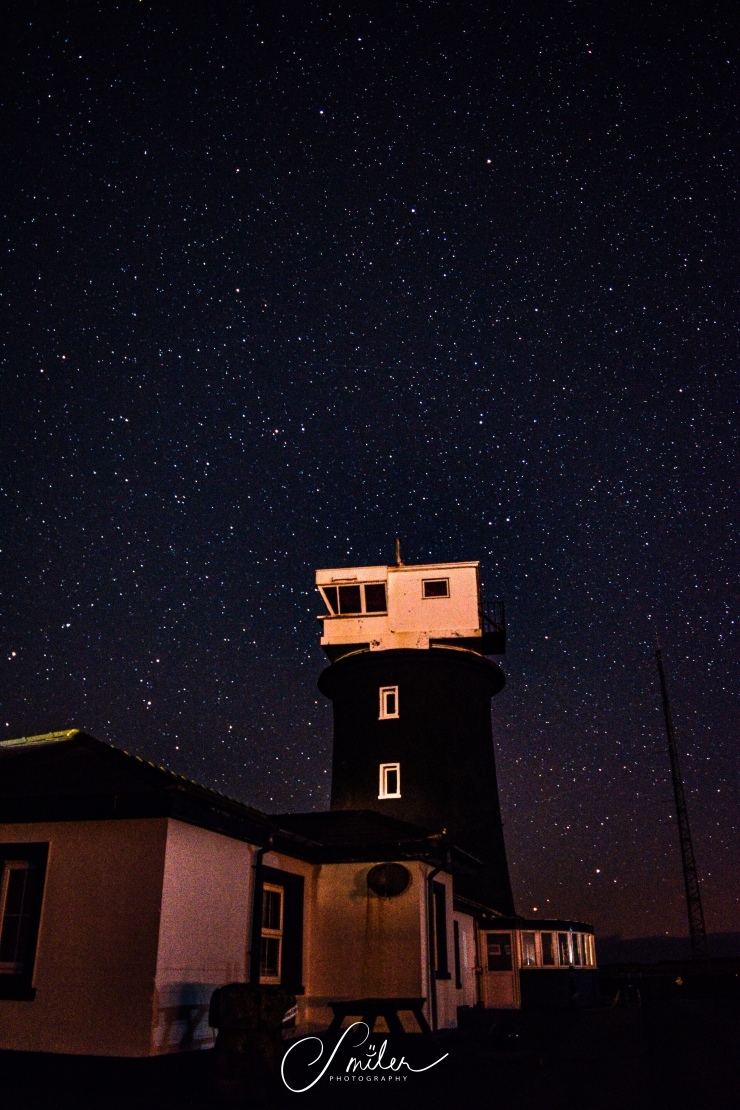 Lighthouse beneath the Stars! Shot at 18mm, f/3.5, 20sec and ISO 1600.